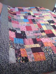 this quilt was made for the Lake County Haven Boutique Raffle